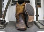 Laarzen die hersteld zijn